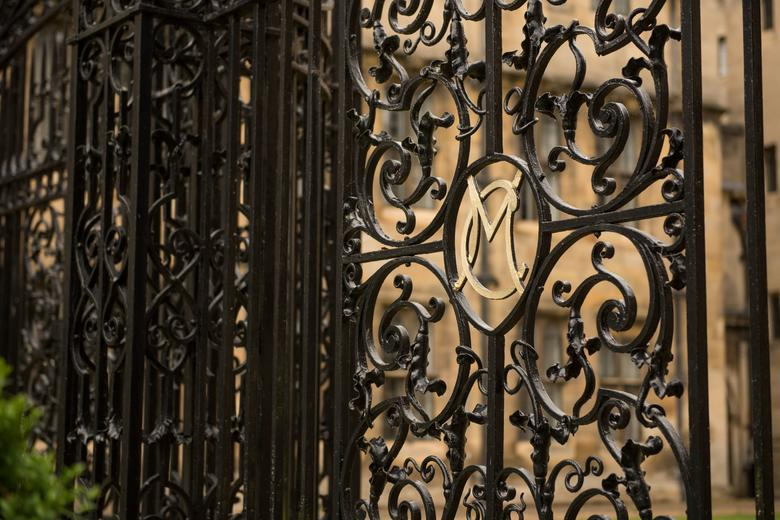 A close up image Merton College gate with a close up of the M